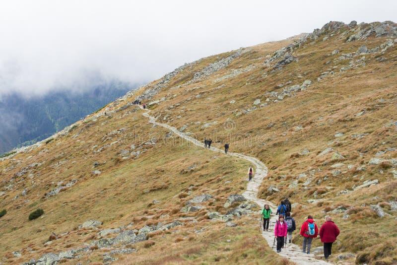 Tatras, SLOVAKIA - JULY 2018: hikers walking mountain ridge path on July 2018 in in High Tatras, Slovakia royalty free stock images