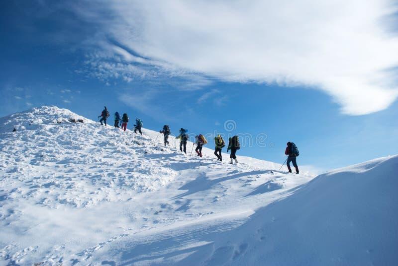 Hikers in a winter mountain, Ukraine, Karpaty stock image