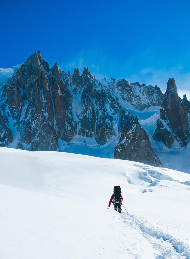 Hikers in winter mountains stock photo