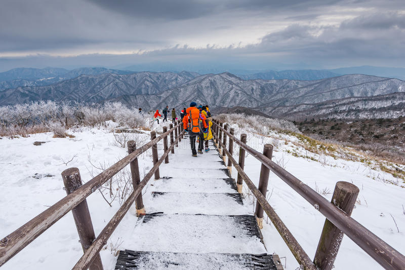Hikers in winter mountains,Winter landscape white snow of Mountain in Korea. royalty free stock photos