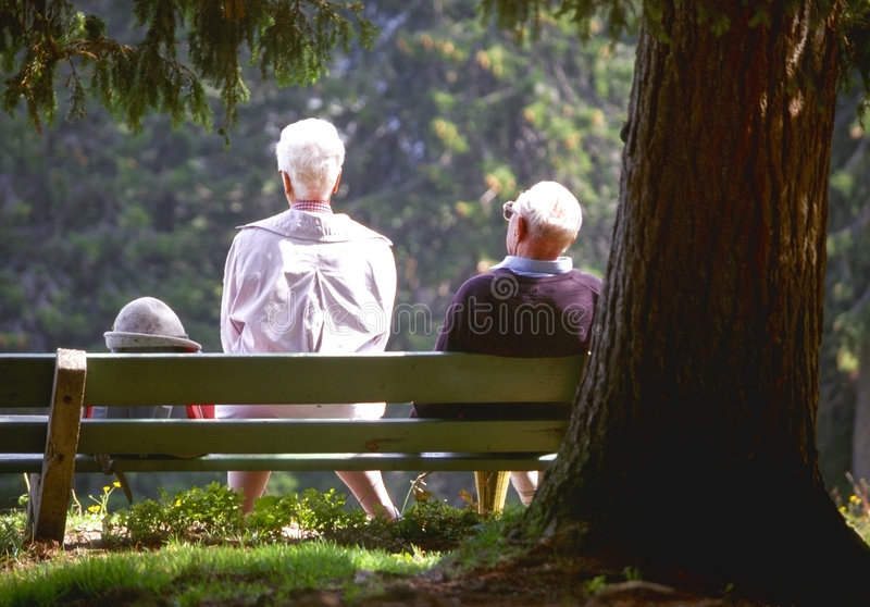 Hiking. Senior couple taking a rest on a hiking trip