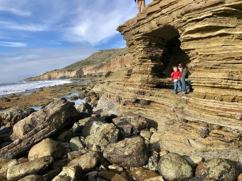 Exploring Cabrillo Tide pools at San Diego with family. Outside exploring tide pools by San Diego with father royalty free stock images