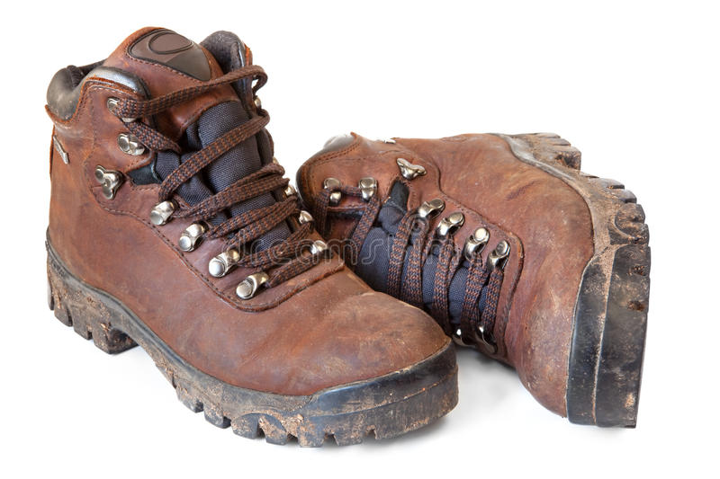 Hiking Boots. Well worn and muddy, isolated on white stock images