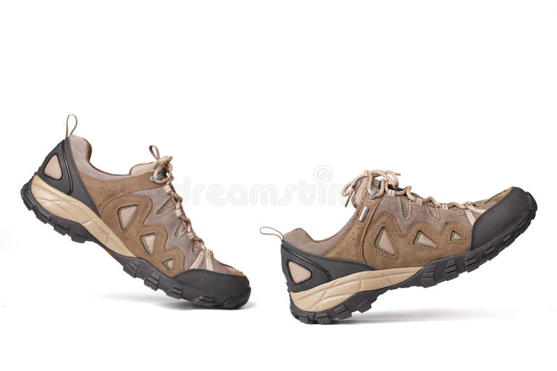 Hiking boots. The hiking boots on a white background royalty free stock photos