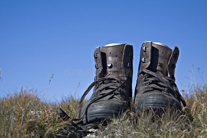 Hiking boots. Rest - hiking boots standing in a mountain meadow royalty free stock image