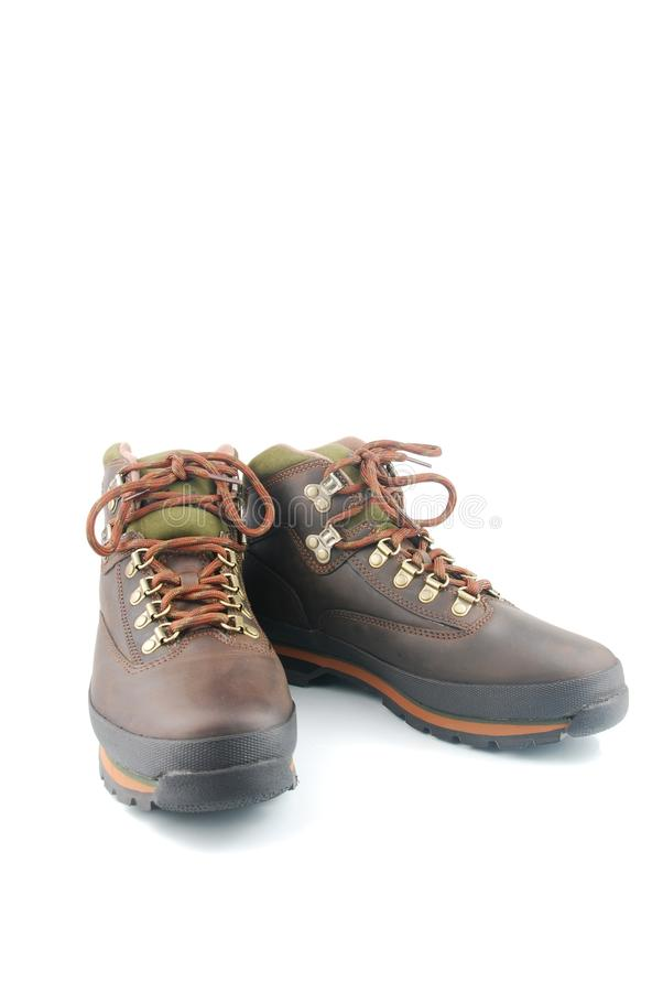Hiking boots. Brown leather hiking boots isolated on white background royalty free stock photos