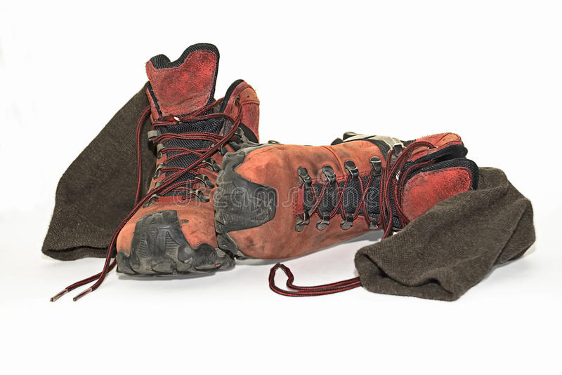 Hiking boots. Dirty, used hiking boots and socks royalty free stock photography