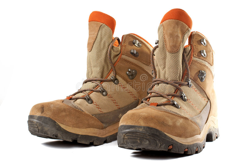 Hiking boots. A pair of used hiking boots over a white background stock image