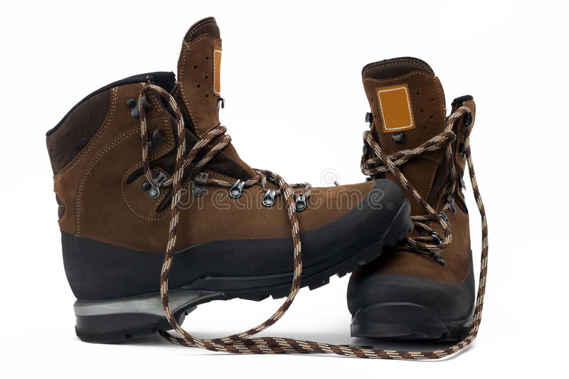 Hiking boots. A pair of new hiking boots on white background stock image