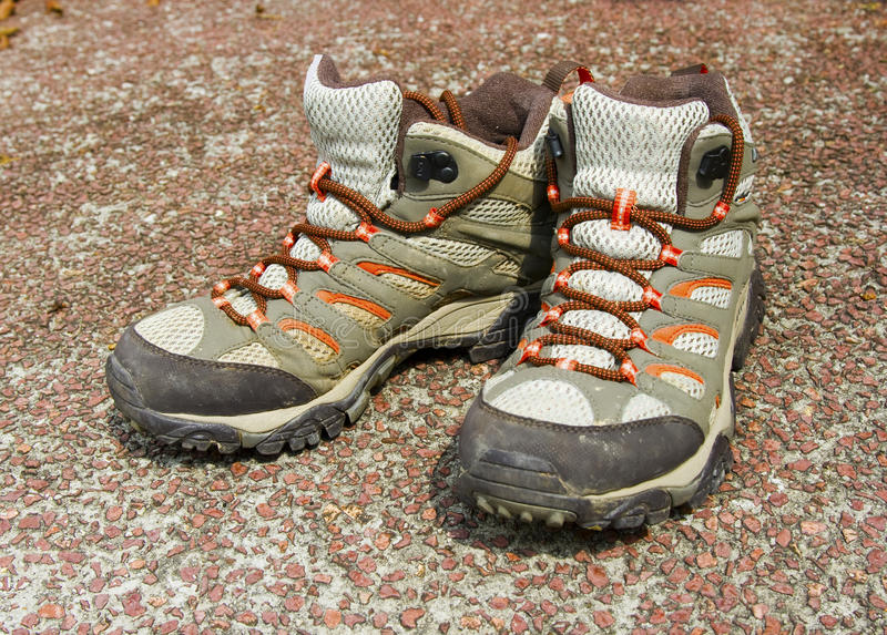Hiking boots. A pair of soiled hiking boots stock photo