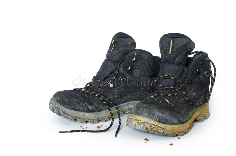 Hiking Boots. A pair of dirty hiking boots isolated in white background stock photography