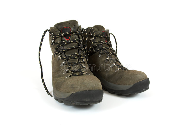Hiking boots. A pair of used hiking boots on white background royalty free stock photography