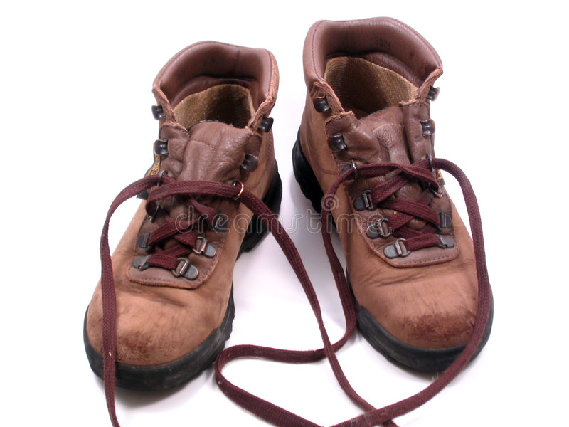 Hiking Boots. A well-worn pair of leather hiking boots royalty free stock images