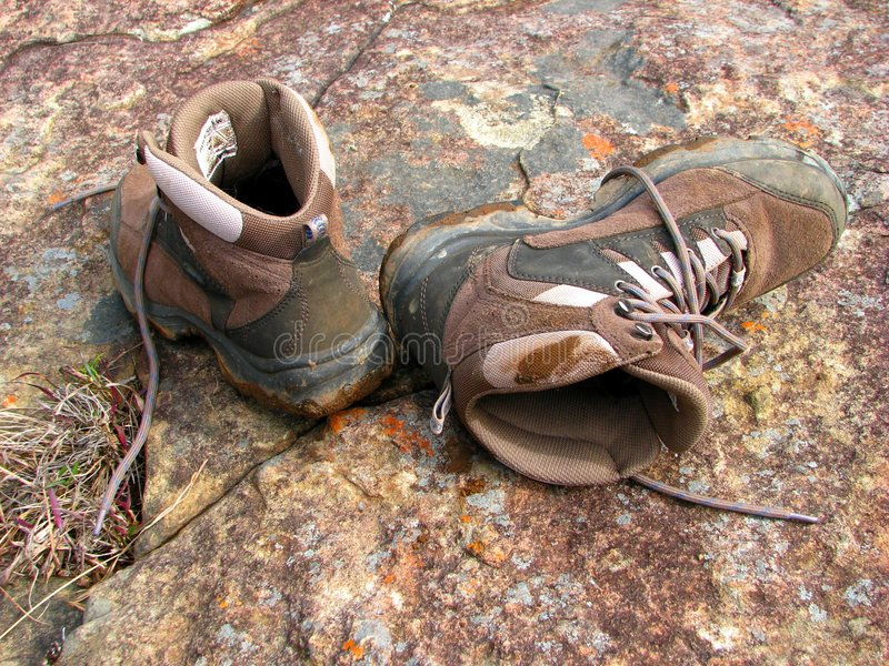 Hiking boots. On the rock royalty free stock photos