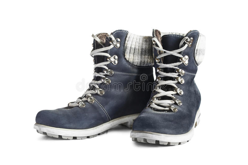 Hiking boots. Blue nubuck leather hiking boots isolated over white stock photography