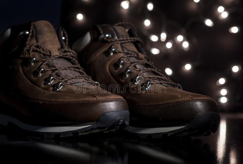 An hiking boots. Brown new hiking boots with a bokeh background royalty free stock photos