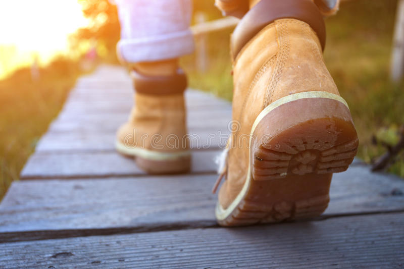 Hiking boots. Close-up. tourist walking at the Puez Odle. Italy royalty free stock photography