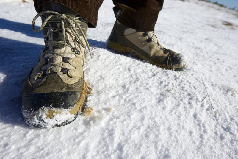 Hiking boots. Closeup of hiking boots in the snow royalty free stock images