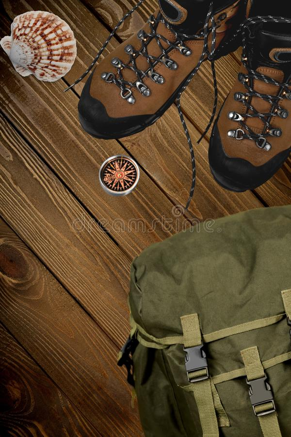 Hiking boots, compass and backpack on background. Boots hiking compass sport activity recreational background royalty free stock image