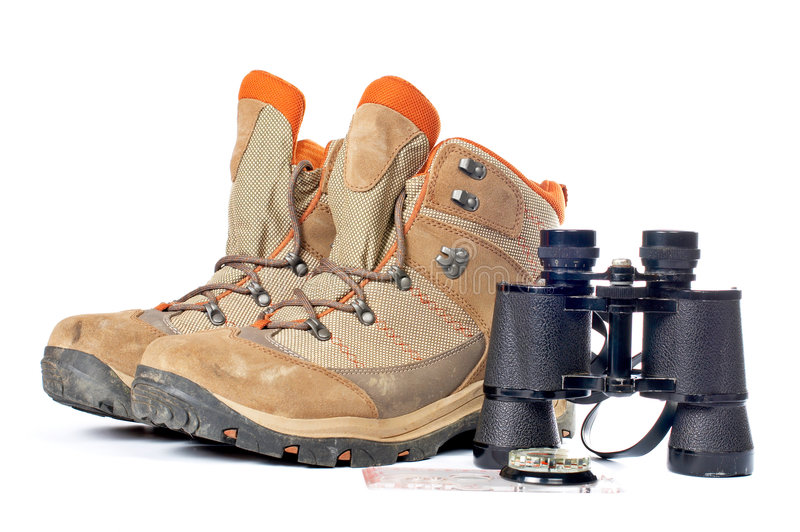 Hiking boots, compass and binoculars. On a white background stock image