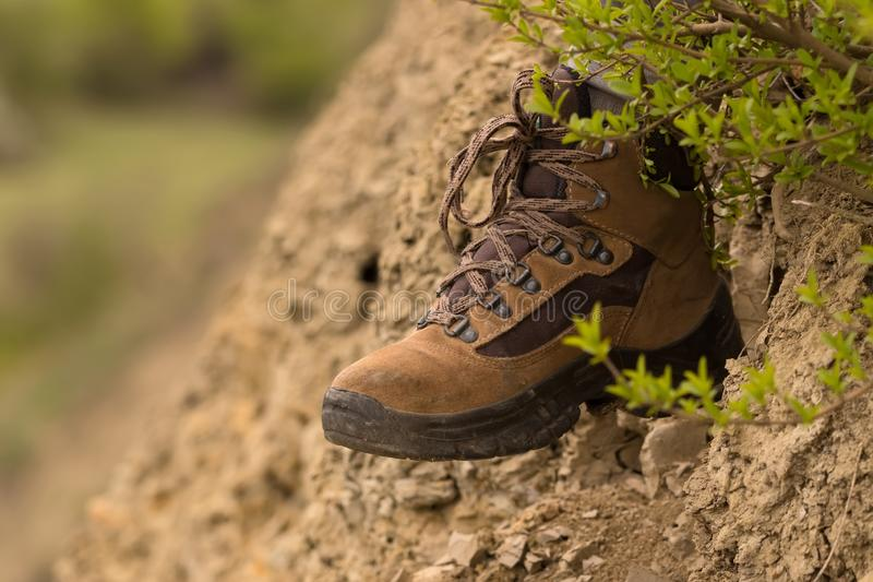 Hiking boots in the field stock images