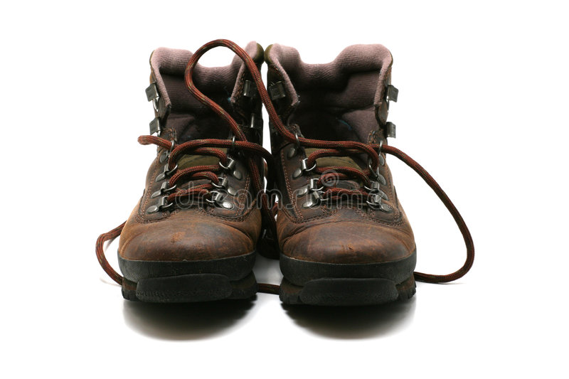Hiking boots - front view. Used hiking boots, front view, on white background stock images