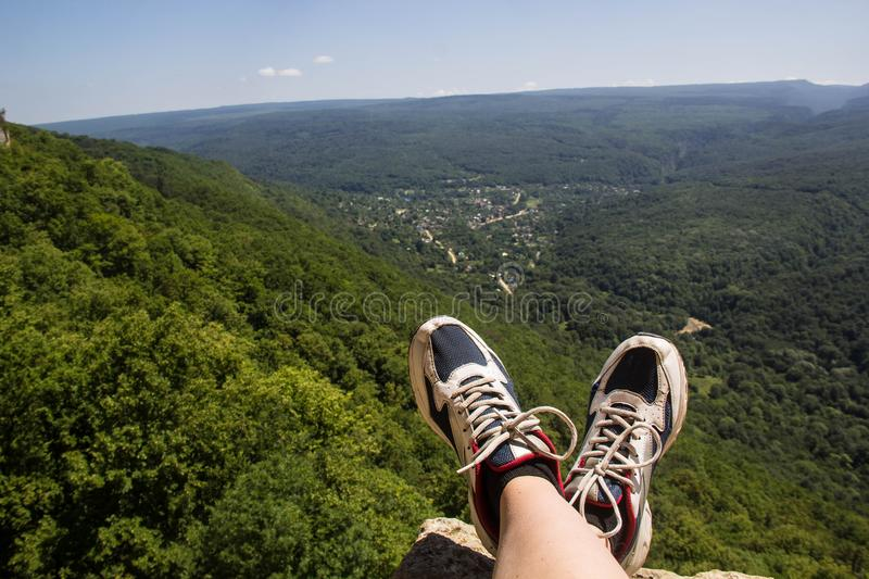 hiking boots having fun and enjoying wonderful breathtaking mountain view. Lifestyle and travel concept. stock photos