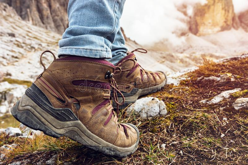 A hiking boots. Hiking boots close-up. tourist walking on the trail. Italy royalty free stock image