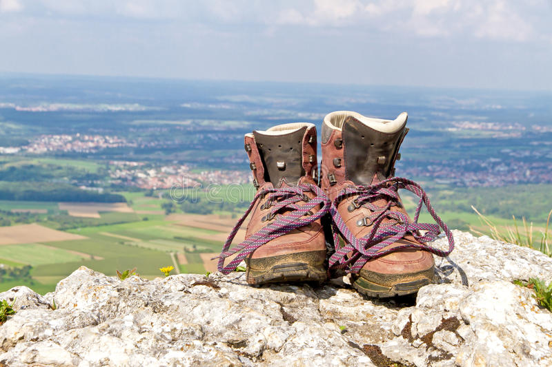 Hiking boots on a mountain. Old hiking boots in nature on a mountain royalty free stock images