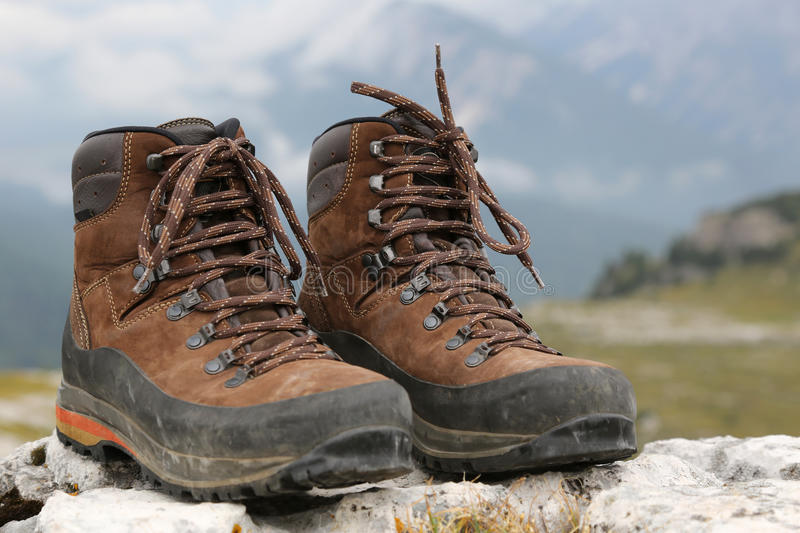 Hiking boots in the mountains Alps stock photography