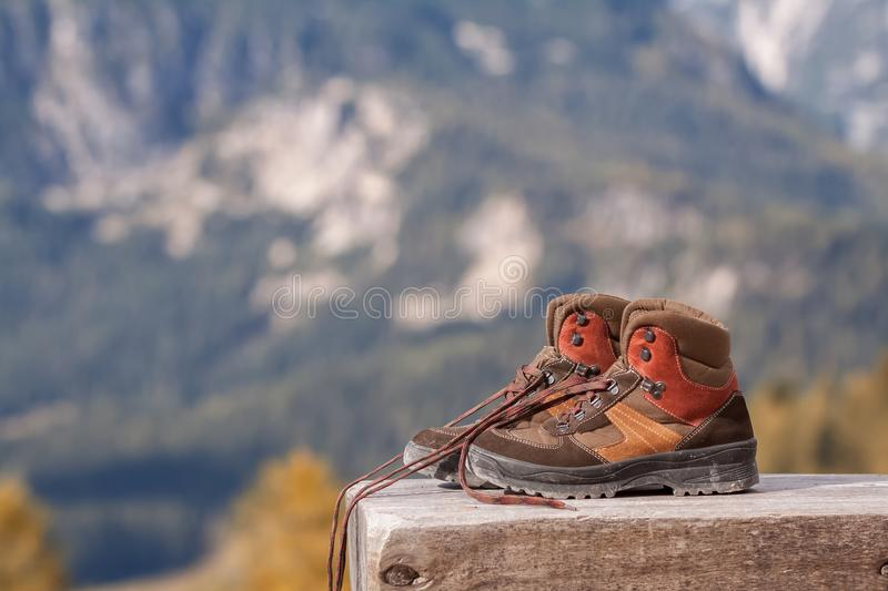 Hiking boots in the mountains on a bench royalty free stock photo