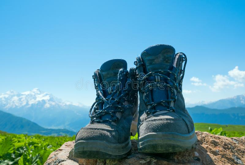 Hiking boots and mountains. Landscape stock photography