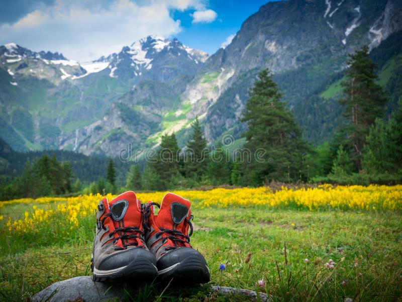 Hiking boots in mountains landscape. Hiking boots and mountains landscape stock photos