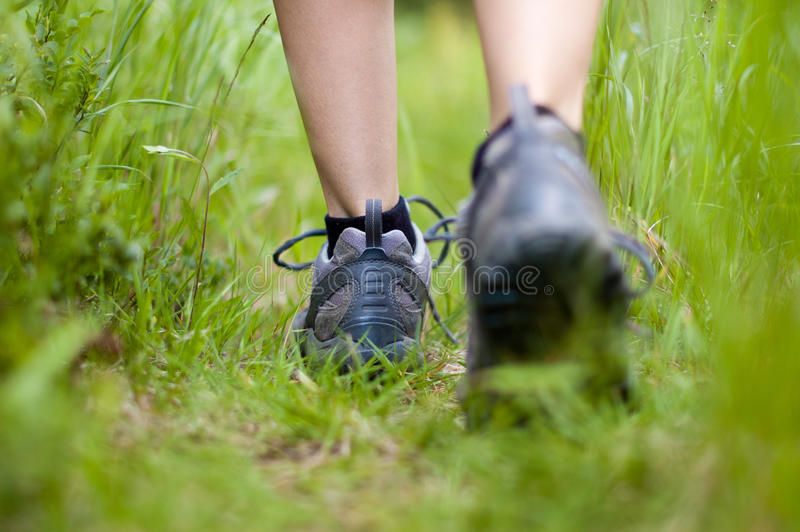 Hiking boots in an outdoor action stock photography