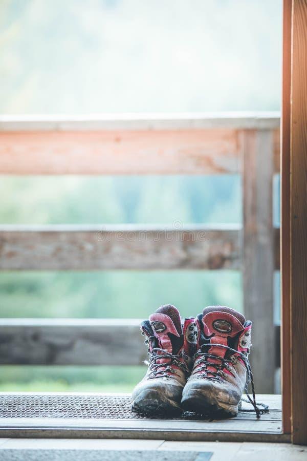 Trekking Boots On The Veranda Of An Alpine Hut. Summer