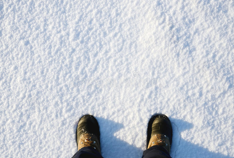 Hiking boots. In the snow stock photography