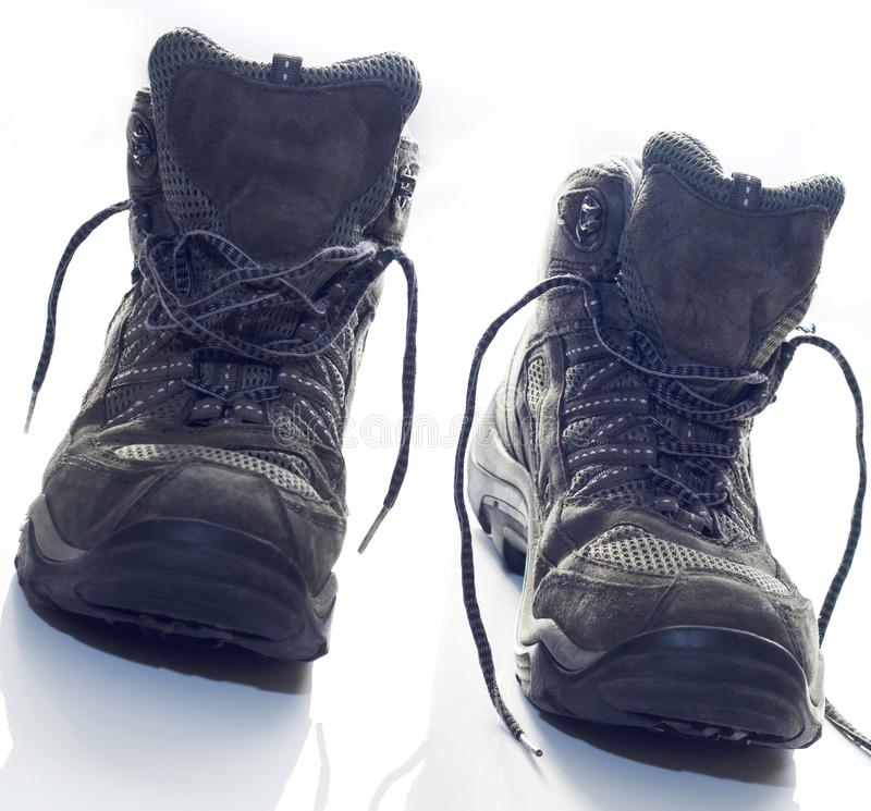 Hiking Boots for outdoor Walking. Hiking boots on white counter top after long day of walking. Laces undone. Walking boots at an angle royalty free stock images