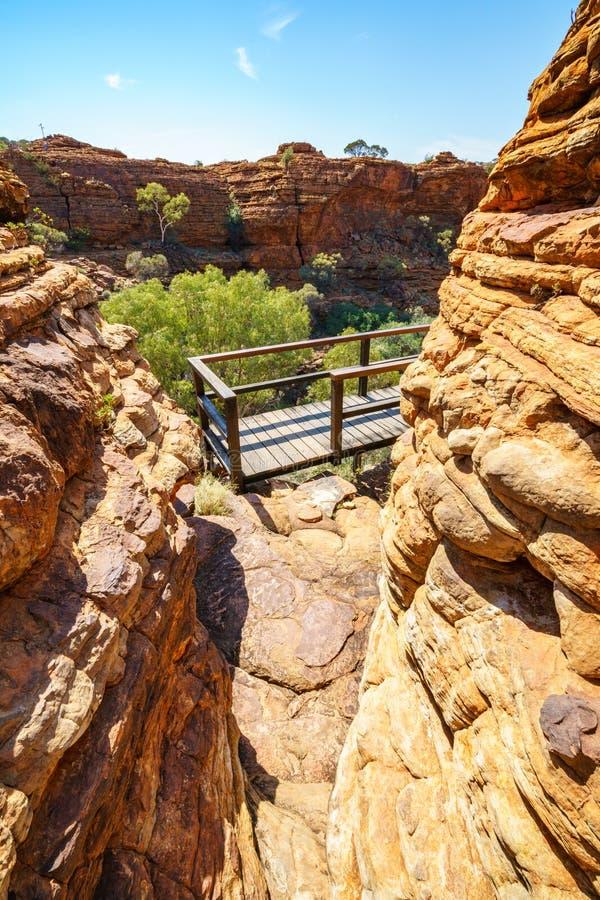 Hiking over the bridge in kings canyon, watarrka national park, northern territory, australia 5. Hiking the bridge in kings canyon on a sunny day, watarrka stock photos