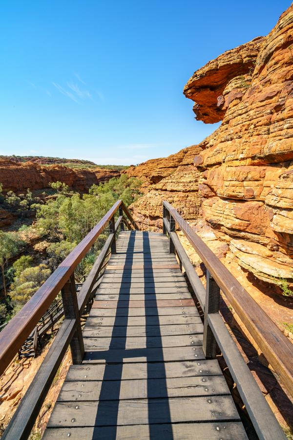 Hiking over the bridge in kings canyon, watarrka national park, northern territory, australia 7. Hiking the bridge in kings canyon on a sunny day, watarrka royalty free stock photography