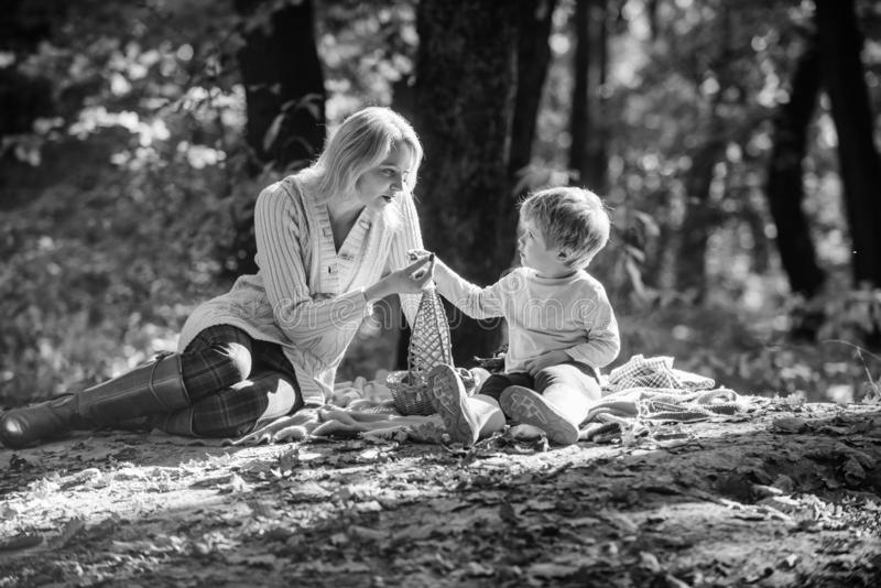 Hiking and camping. Spring mood. Happy family day. Mother love her small boy child. Family picnic. Mothers day. Sunny. Weather. Healthy food. Happy son with stock images