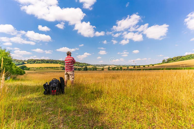 Hiking In The Chilterns. Hiker taking a rest from hiking in the Chilterns, UK stock photo