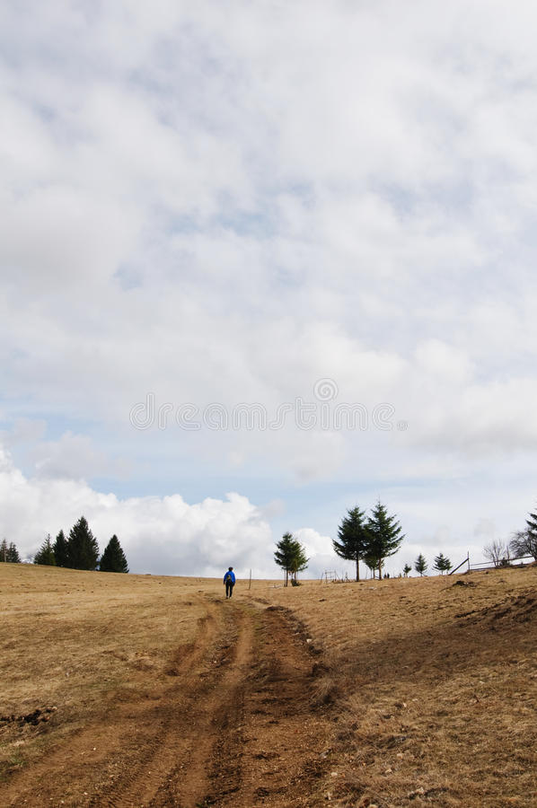 Hiking on a cloudy day. Girl hiking on a cloudy day royalty free stock photography