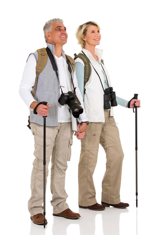Hiking couple holding hands stock images