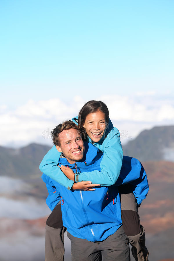 Download Hiking Couple Piggybacking Happy Stock Photo - Image: 27048110