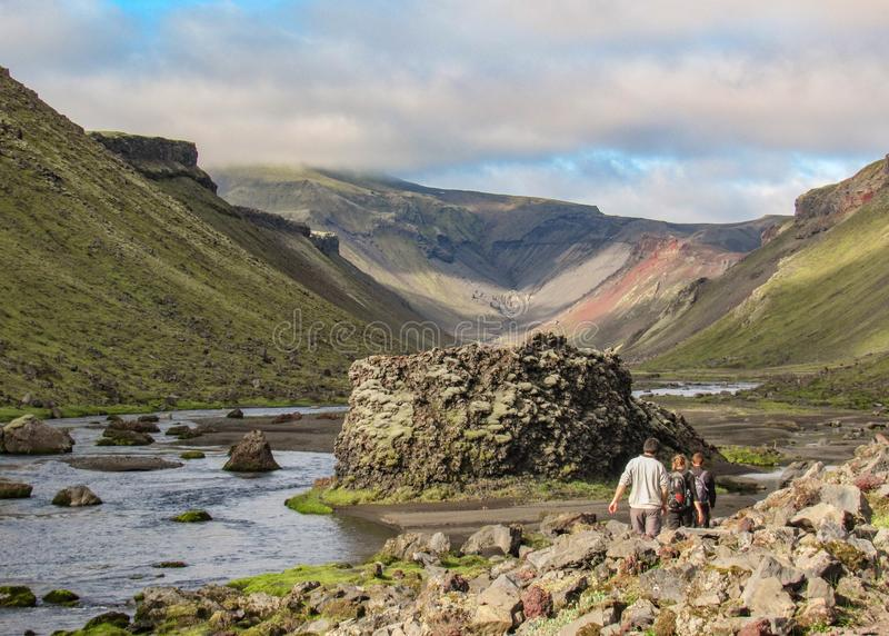 Three hikers walking in the world`s largest volcanic canyon Eldgja, central Iceland royalty free stock photography