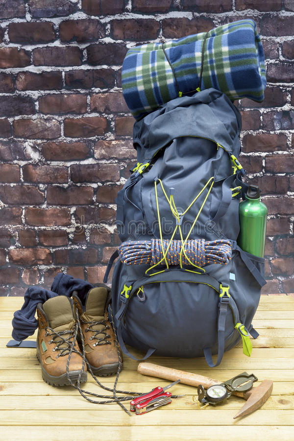 Hiking equipment, rucksack, boots and backpack. Concept for family hiking. Colorful background stock photography