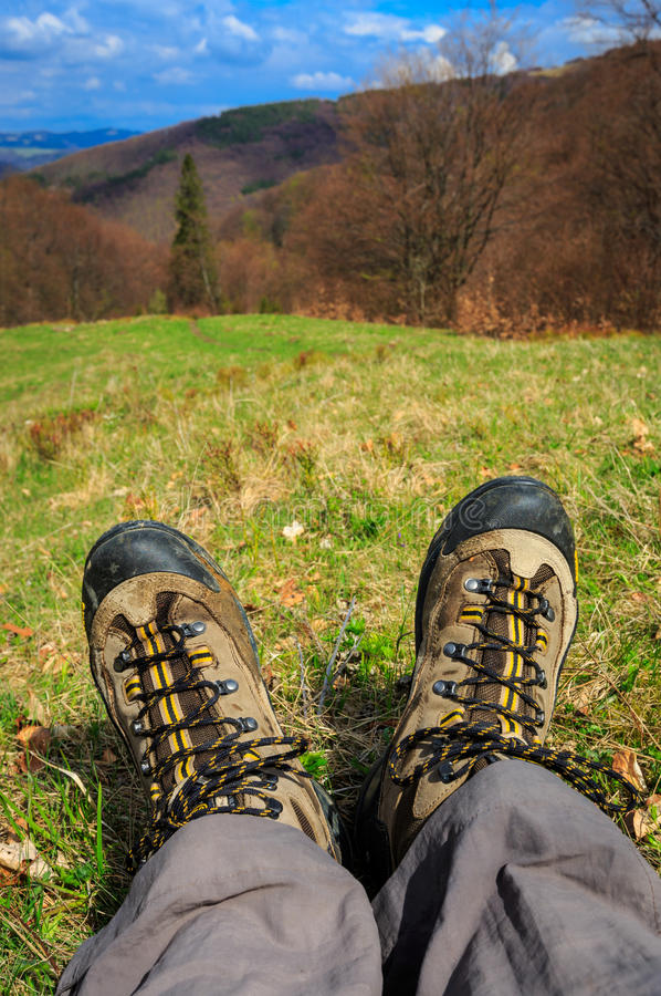 Hiking Feet on mountain meadow. Hiking Feet over valley in mountains stock photography