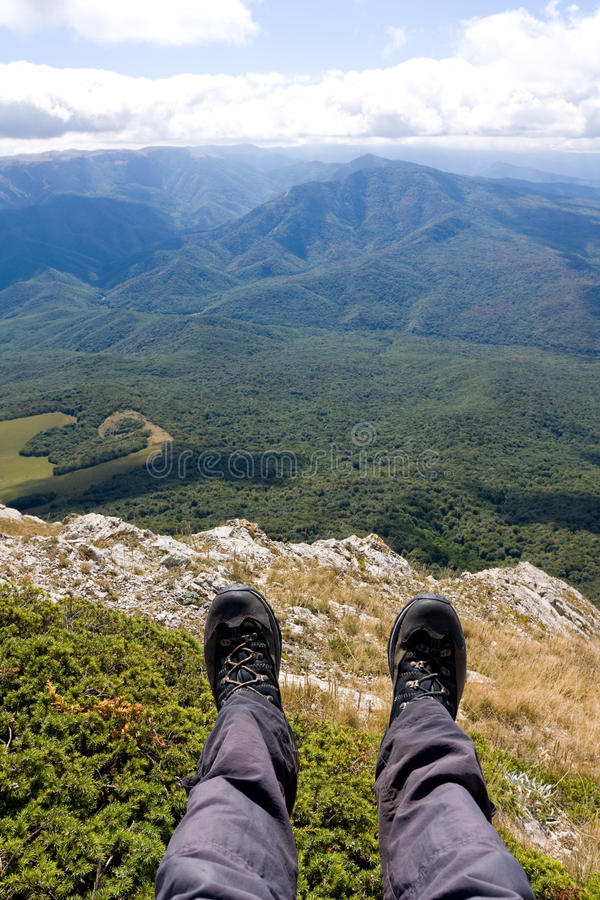 Hiking Feet over valley. In mountains royalty free stock photo