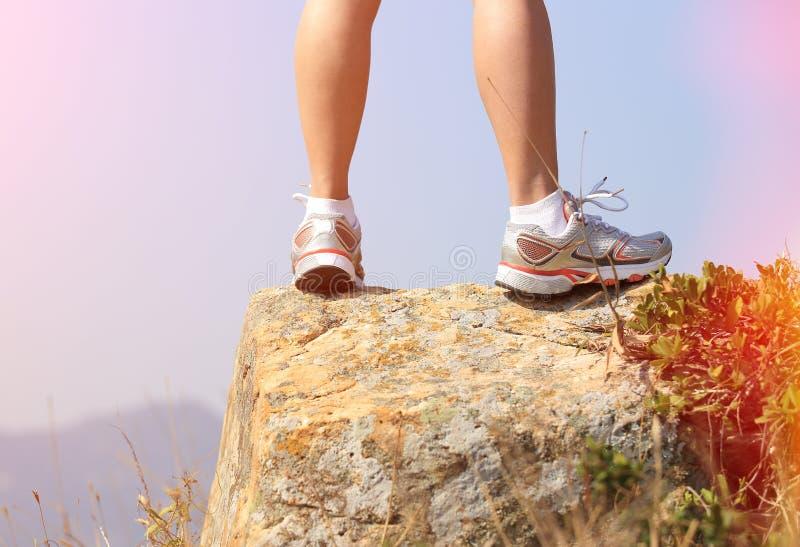 Hiking feet stand seaside rock. Hiking feet stand seaside mountain rock royalty free stock photos