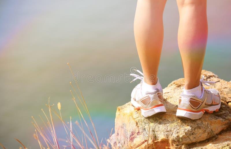 Hiking feet stand seaside rock. Hiking feet stand seaside mountain rock royalty free stock photo